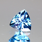 ok. 0,605ct/1szt. - TOPAZ NAT.- 5,12x5,10/3,57mm trilion